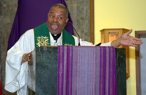Father Chester Smith, a missionary for the Society of the Divine Word, preaches during the black Catholic revival at St. Helen Church, Lauderdale Lakes.