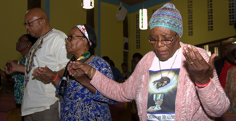 Worshipers pray Hail Marys during the black Catholic revival at St. Helen Church, Lauderdale Lakes.