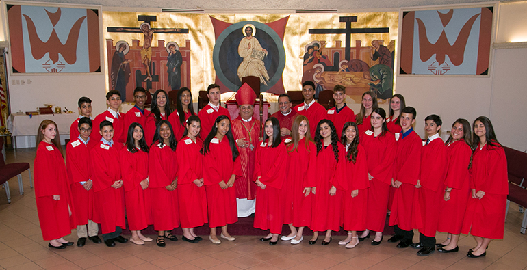 Mother of Christ School's 2018 confirmation class pose with Auxiliary Bishop Enrique Delgado and Father Jorge Carvajal after the two presided at their first confirmation since their new appointments. Bishop Delgado as bishop and Father Carvajal as parish administrator.