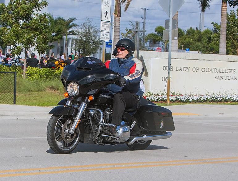 Archbishop Thomas Wenski sets out on his annual ride to raise funds for Catholic Charities' St. Luke's Center, a rehabilitation facility for those addicted to drugs and alcohol. The ride began with morning Mass at Our Lady of Guadalupe Church, Doral, and ended at Peterson's Harley-Davidson in Northwest Dade, with dozens of fellow bikers taking part.