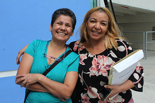 Martina Guillen, right, poses with her godmother Claudia Garzon. Guillen, who is originally from the Dominican Republic, was convinced by her godmother, a native of Colombia who became a U.S. citizen years ago. The two saw a commercial for the New Americans Campaign Mega Citizenship Workshop and knew it was time for action.