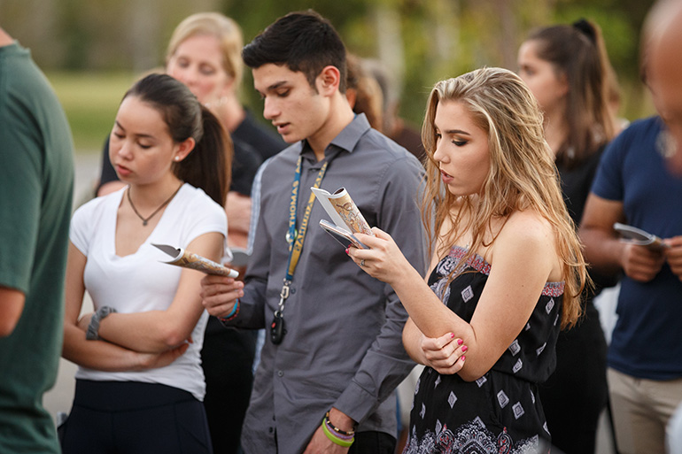 Members of Mary Help of Christians Parish in Parkland, join in a Friday Lenten Stations of the Cross service on Feb. 16 dedicated to the victims and survivors of the deadly Feb. 14 shooting at nearby Marjory Stoneman Douglas High School  which resulted in 17 student and faculty fatalities. At least one member of the parish was among the deceased, according to the parish administrator.