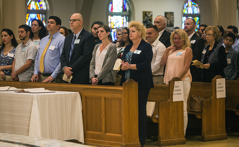 Catechumens, flanked by their sponsors, fill the pews of St. Mary Cathedral during the first of two Rite of Election ceremonies held Feb. 18, the Sunday after Ash Wednesday.