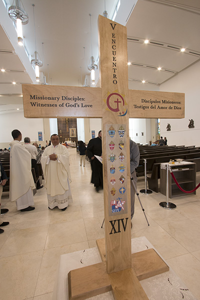 The cross of the V Encuentro stands at the entrance to Our Lady of Guadalupe Church, Doral, at the start of the Regional Encuentro's opening Mass.