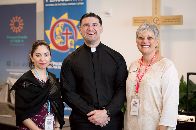 Posing for a photo during a break in the Southeast Regional Encuentro Feb. 23, from left: Eva Gonzalez, Hispanic Ministry director from the Archdiocese of Louisville, Ky., and Encuentro coordinator for Region V; Father Rafael Capo, director of the Miami-based Southeast Regional Office for Hispanics and the Southeast Pastoral Institute (SEPI); and Vivi Iglesias, a Catholic Relief Services staff person in St. Petersburg who serves as Encuentro coordinator for Region XIV.