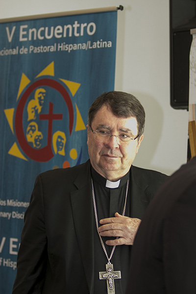 Archbishop Christophe Pierre, papal nuncio to the U.S., stops by the final working session of the Southeast Regional Encuentro Feb. 24, before celebrating the closing Mass with the delegates.