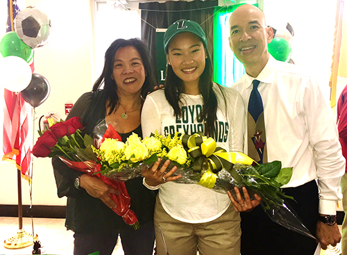 Msgr. Edward Pace High senior Grace Li poses with her father, Pace alumnus and now faculty member Phillip Li, and her mother, Alice Li.