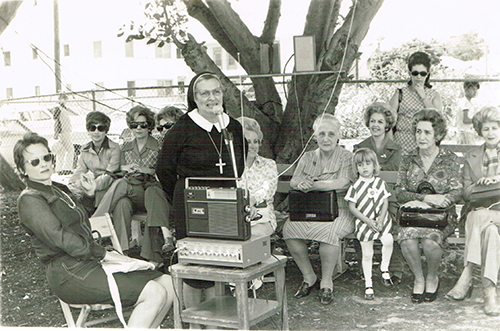 Mother Margarita Miranda Otero hosts a neighborhood meeting during the 1970s on the grounds of Centro Mater East in Little Havana.