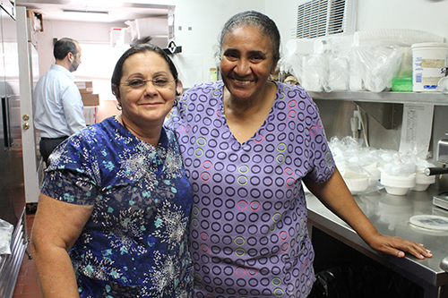 Keeping the kids happy and well fed are Centro Mater's cooks Lourdes Palacios, left, and Asusena