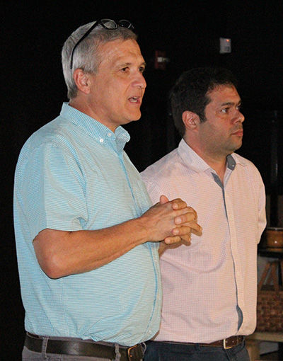 Carl Wilkens, left, stands with Immaculata-La Salle English and political science teacher JC Moya at the beginning of the presentation on the 1994 genocide in Rwanda.