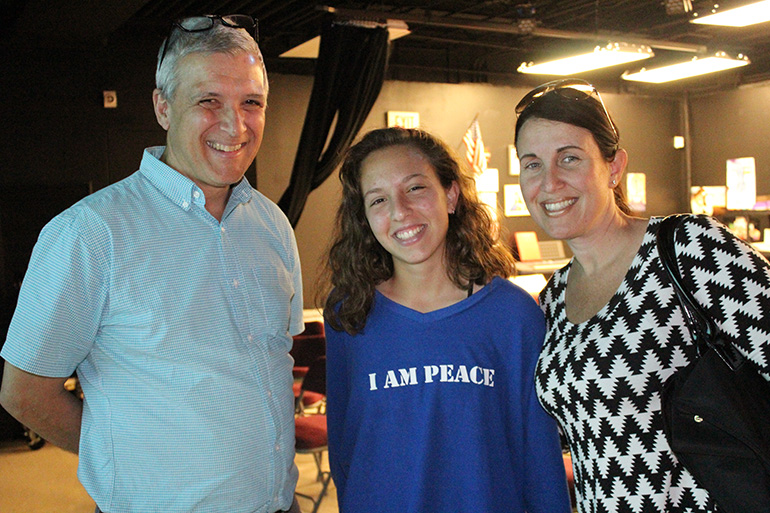 Dressed for peace: Immaculata-La Salle junior Valentina Alaimo wears a sweater supporting peace to Carl Wilkens's lecture about Rwanda. With her is her mom, Antonella Vaccaro.