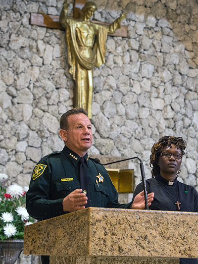 Broward Sheriff Scott Israel addresses BOLD Justice members as Rev. Andrea Byer-Thomas, of Village United Methodist Church in North Lauderdale, stands next to him. Israel spoke at BOLD Justice's 11th annual Nehemiah Action assembly, held April 23 at St. David Church in Davie.