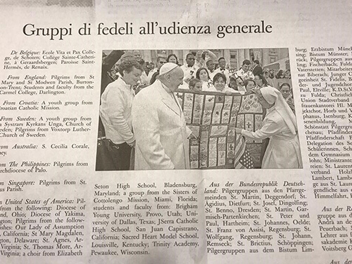 A photo in the Osservatore Romano April 5 features an image captured the moment Marian Center performers presented Pope Francis with the quilt the school's students had made.