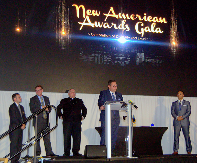 Mario Murgado gives his acceptance speech as one of three honorees at the 20th anniversary gala for Catholic Legal Services in Miami on April 27.
