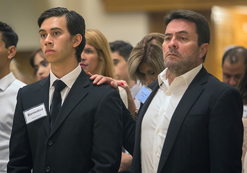 Antonio Jose Vallejo, sponsor, puts his hand on shoulder of Carlos Faccin, candidate, during the second of two Rite of Reception ceremonies April 29 at St. Mary Cathedral.