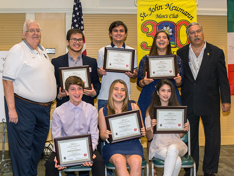 Dan Lamey, left, St. John Neumann Men's Club president, and Eric Schwindeman, chair of the group's merit scholarships committee, pose for a photo with the first scholarship winners. Back from left: Diego Guerrero, 18, Gregory Mesa, 18, Alyssa Bell, 18; front, from left: Gabriel Taboro, 15, Daniela Hoyos, 13, and Lauren Morera, 14.