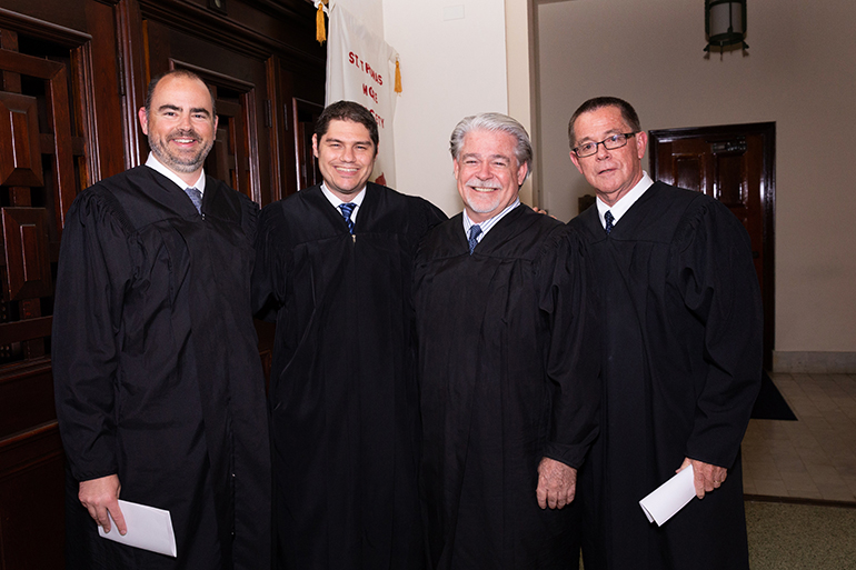 Judges Tom Coleman, Michael Davis, Dennis Bailey and Tim Bailey pose at the annual Red Mass of the St. Thomas More Society for South Florida, May 15 at St. Anthony Church in Fort Lauderdale.