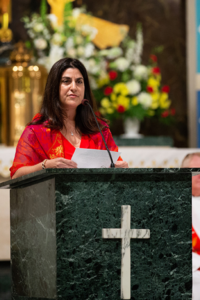 Jamie Finizio Bascombe proclaims the first reading at the annual Red Mass of the St. Thomas More Society of South Florida, held May 15 at St. Anthony Church in Fort Lauderdale.