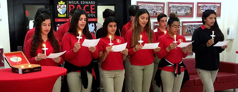 New members of Pace High School's National Spanish Honor Society recite the organizationÕs pledge at their induction ceremony June 1.