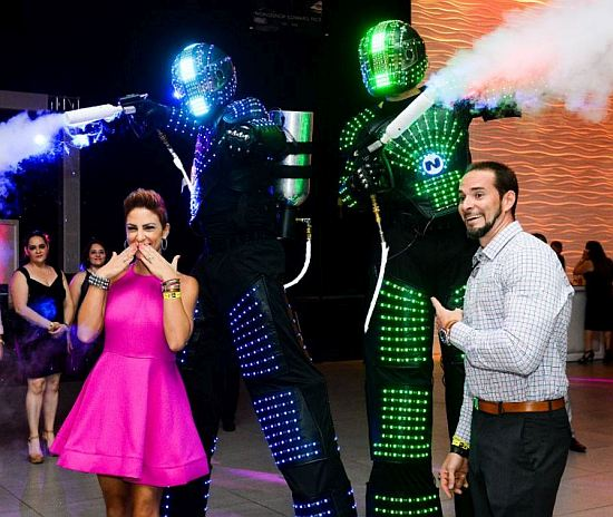 Kristina Bergolla Delgado, of Pace High School's class of 1998, and Danny Delgado, from the class of 1997, enjoy the robotic performers at the school's first alumni prom.