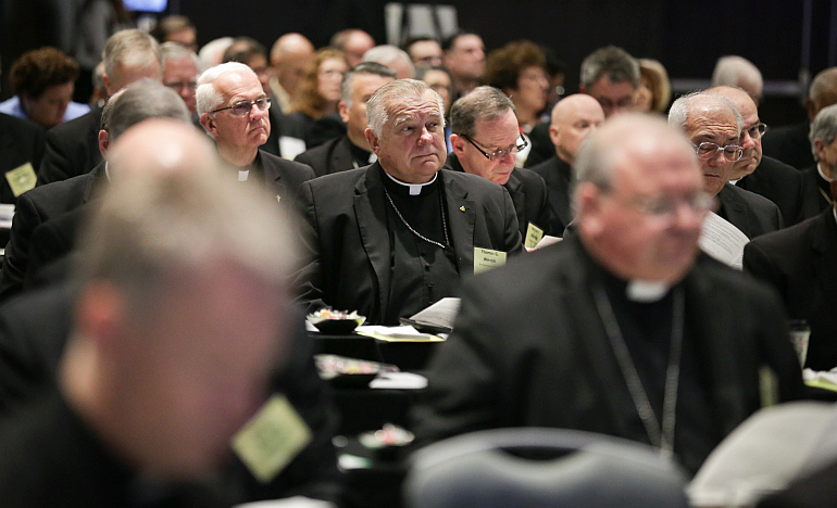 Archbishop Thomas Wenski sits in on a session at the spring meeting of the United States Conference of Catholic Bishops in Fort Lauderdale.