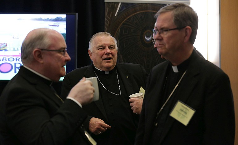 Archbishop Wenski chats with fellow bishops during a break at the spring meeting of the United States Conference of Catholic Bishops in Fort Lauderdale.
