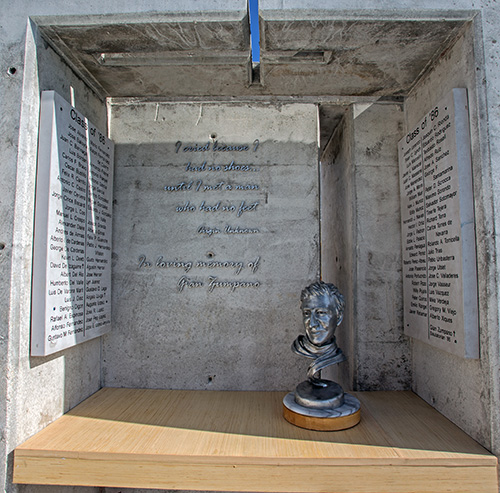 View of the grotto with Gian Zumpano's bust and reflecting cross on top wall of grotto at Belen Jesuit's new Gian Zumpano Aquatic Center.