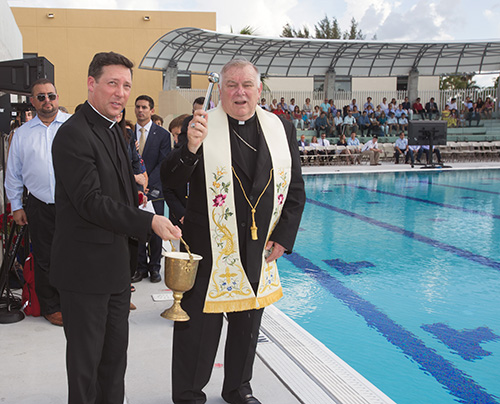 Archbishop Thomas Wenski blesses Belen Jesuit's new Gian Zumpano Aquatic Center.