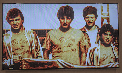A photo from the 1980s of Belen swimmers Jorge Baste, Gian Zumpano, Joe Zumpano and Henry Artalejo, seen during a video presented at the dedication of Belen Jesuit's new Gian Zumpano Aquatic Center.