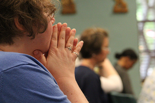 A consecrated virgin prays during Mass July 8 at MorningStar Renewal Center in Pinecrest.