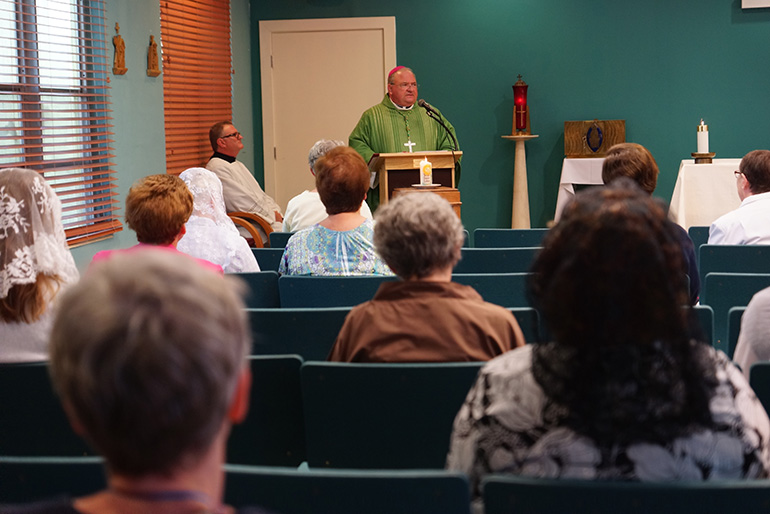 Miami Auxiliary Bishop Peter Baldacchino preaches the homily at the closing Mass July 10 of the U.S. Convocacation of Consecrated Virgins, celebrated at MorningStar Renewal Center in Pinecrest.