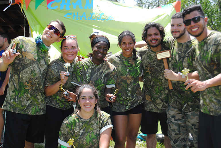 The winning Camo Team pose with their trophies and prize. From left: Jesus Valentino, Yamileth Ayala, Rachel Mpanu, Gaby Soto, Jorge Jimenez, Brian Fernandez, Carlos Rodriguez and Tania Aranacano. One-hundred sixty young adults from throughout the Archdiocese of Miami, divided into co-ed teams with eight members each, took part in the first Champions Challenge, an afternoon of fun and field games that also doubled as an opportunity for fellowship and evangelization. The event took place July 21, 2018 at Tropical Park in Miami.