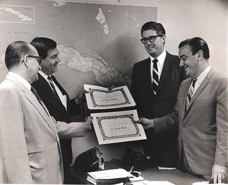 Channel 4 Latin American News Editor Manolo Reyes, far right, is pictured here with Ralph Renick, WTVJ vice president for news, receiving certificates of appreciation from officers of the Cuban Anti-communist Journalism Association. (FILE PHOTO)
