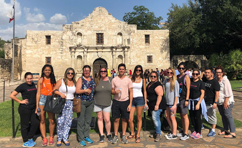 St. Thomas Law team of students, professors and mental health experts pose for a photo during their time in Texas.