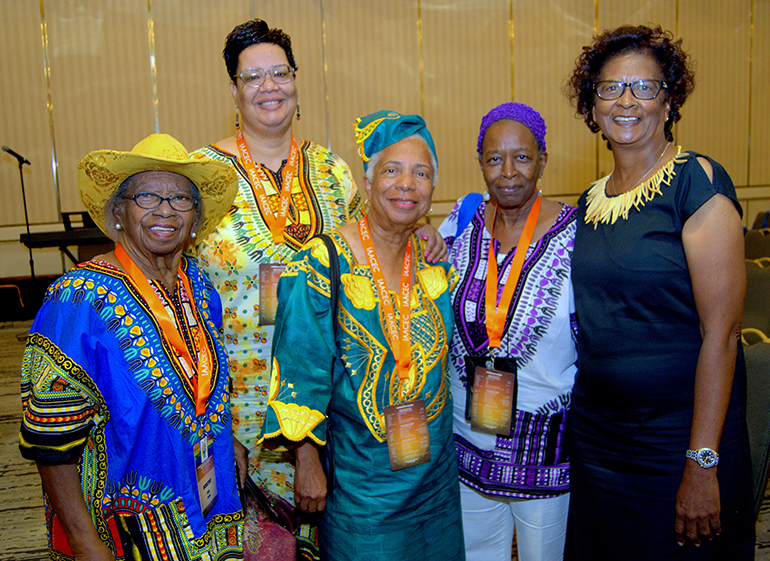 Attendees from the Archdiocese of Miami pose for a photo at the Interregional African American Catholic Evangelization Conference. From left are Dorothy Paul, Tamara Hospedales, Wilhelmina King, Donna Blyden and Virginia Cox.