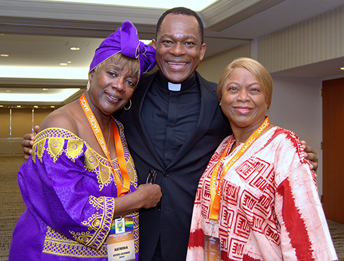Katrenia Reeves-Jackman, left, poses with Father Maurice Emelu and M. Annette Mandley-Turner, founder of the Interregional African American Catholic Evangelization Conference. Reeves-Jackman directs the Office of Black Catholic Ministry for the Archdiocese of Miami.