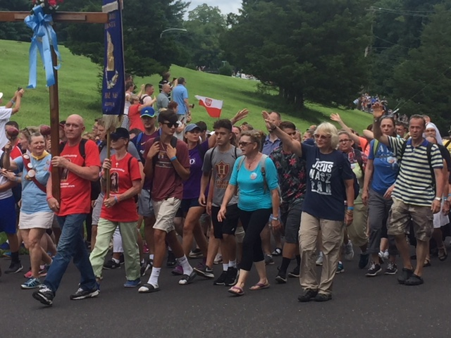 The first group of walking pilgrims arrive at the American Czestochowa in Doylestown, Pennsylvania. The annual 60-mile pilgrimage started Aug. 9 and concluded Aug. 12 and concluded with Sunday Mass. This is the 31st year of the pilgrimage and more than 2,500 men, women and children participated. Archbishop Thomas Wenski, whose parents were Polish, has participated for many years.