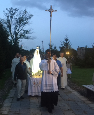 Participants carry an image of Our Lady of Fatima during a nighttime procession Aug. 13 at the Shrine of Our Lady of Czestochowa in Doylestown, Pennsylvania.