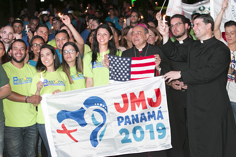 Archbishop Jose Domingo Ulloa of Panama poses for a photo with young people from South Florida who will be attending World Youth Day in Panama in January. Next to him are Father Bryan Garcia and, far right, Father Rafael Capo. Archbishop Ulloa, joined by Archbishop Thomas Wenski, Auxiliary Bishop Peter Baldacchino, Pueblo Bishop Emeritus Fernando Isern and priests from St. John Vianney Seminary and the archdiocese, celebrated Mass at the seminary the evening of Aug. 22 to pray for priests and religious. The Mass was followed by a vigil on the grounds of the seminary with the World Youth Day Cross and icon, attended by about 300 people.