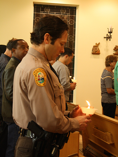 Miami Dade Police Department Major Jesus Ramirez prays for those afflicted by addition during the traditional Latin Mass offered to end the opioid epidemic. The Mass was celebrated at Mission La Milagrosa on Feb. 2, 2018, feast of the Purification of the Blessed Virgin Mary.