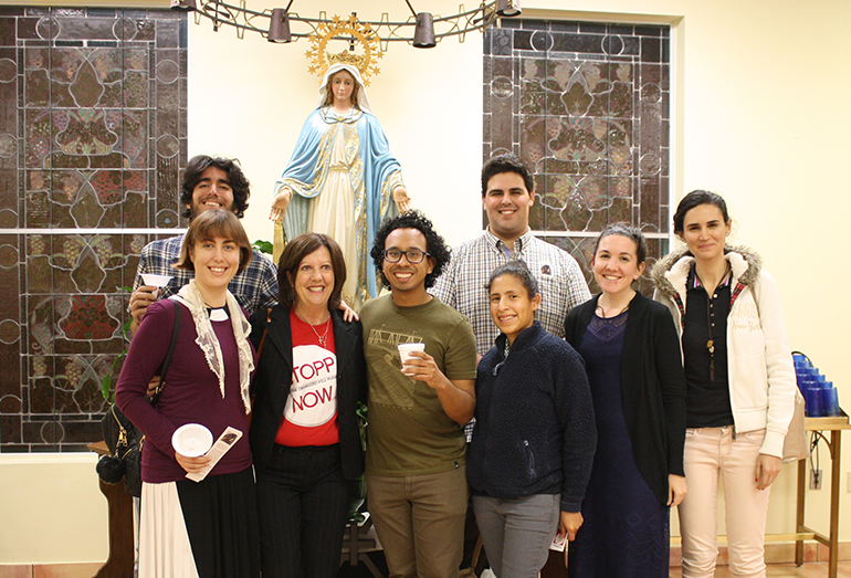 Members of the Latin Mass young adult community pose with Janet Colbert (second from left) after the Feb. 2 Mass at Mision La Milagrosa in Miami; front, from left: Francesca Hunter, Jose Ballon, Kelly Vargas, Emily Mangiaracina, Tatiana Talamas; rear left, Matthew Gutierrez; rear right, Anthony Garcia.