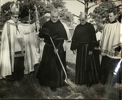 Augustinian Provincial Father James A. Donnellon breaks ground for the first Catholic men's college in South Florida, now St. Thomas University, as Bishop Coleman Carroll, left, and Augustinian Father Edward McCarthy, second from right, the new college's rector, look on.
