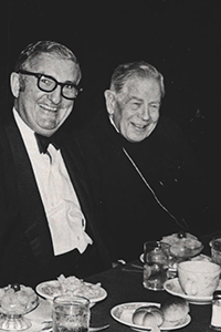 Joe Robbie is pictured here at a fundraising dinner with Archbishop Coleman Carroll.