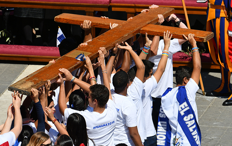 Young people from Panama and other parts of Central America carry the World Youth Day cross during the Palm Sunday Mass, April 9, 2017 at St. Peter's Square in the Vatican. Panama will host the 2019 World Youth Day, Jan. 22-27, 2019.