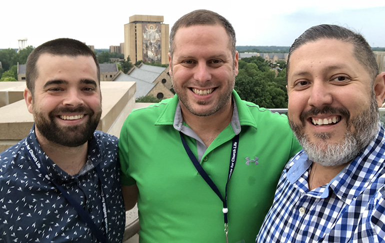 Eric Beltran, right, poses with two other faculty from Immaculata-LaSalle High School at Notre Dame University, where they attended seminars in science and religion this summer. From left are Nicholas Shaheen and Michael Pena.