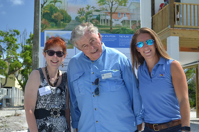 Michele McHale-Pickard of the Florida Keys Community Land Trust, left, poses with Chuck Brush, president of the South Miami-Dade Council of the St. Vincent de Paul Society, and Emily Nixon, deputy director of the SOS Foundation, at the dedication of the first of four Keys Cottages.
