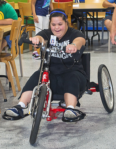 The Marian Center's Ashley Acoccella tries out the cycle.
