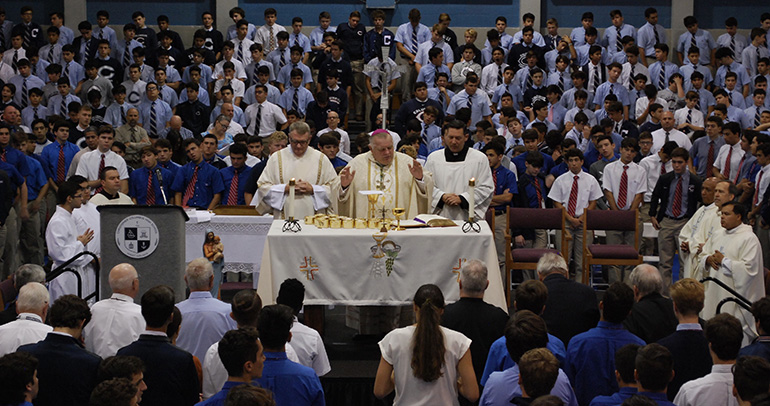 Archbishop Thomas Wenski celebrates an all-school Mass Aug. 30 marking the start of the 60th school year at the Marist Brothers' Christopher Columbus High School in Miami.