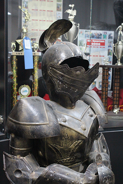 A Curley Knight mascot that once stood in Archbishop Curley Notre Dame High now stands among Msgr. Edward Pace High memorabilia.