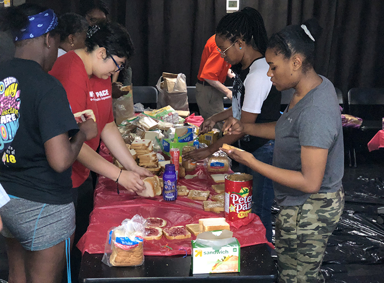 Students from Msgr. Edward Pace High and Chaminade Madonna College Prep prepare sandwiches during Hunger Fest 2018. The retreat, which was brought over as a tradition from Archbishop Curley-Notre Dame High, celebrated its 22nd year at its new home in Pace.